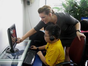 Teacher and student use computer